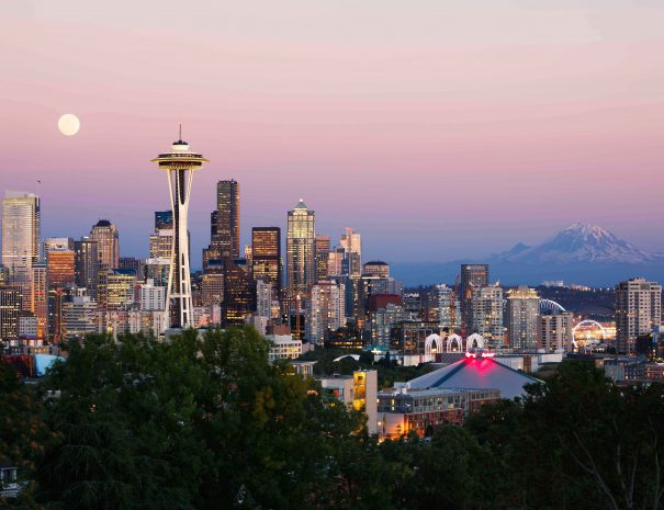 Seattle skyline at dusk with the mount Rainier in the background.